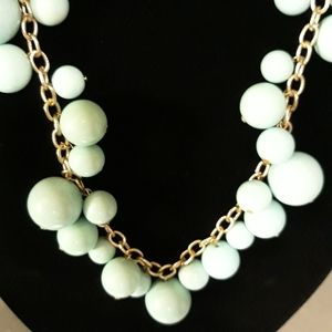 Gold tone chain with blue beads